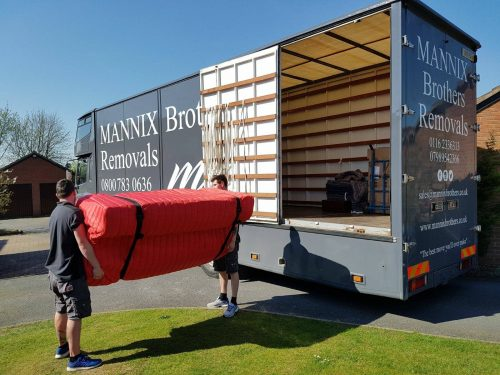 Loading sofa onto removals truck