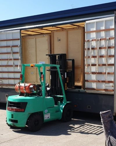 Loading storage containers into lorry