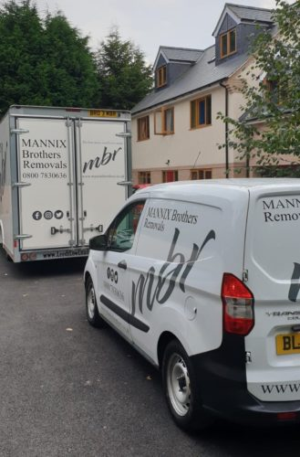 The Mannix Brothers vans outside home